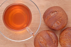 Cup of tea and fresh buns Stock Photo