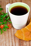 Cup of tea and fresh croissant Stock Photo