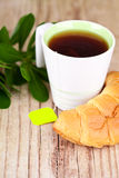Cup of tea and fresh croissant Royalty Free Stock Photo