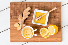Cup of tea with fresh ginger root,  lemon and honey on wooden cu Royalty Free Stock Photography
