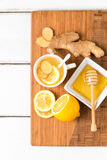 Cup of tea with fresh ginger root,  lemon and honey on wooden cu Royalty Free Stock Image