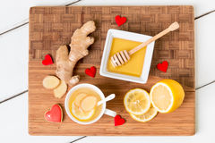 Cup of tea with fresh ginger root,  lemon and honey on wooden cu Royalty Free Stock Photos