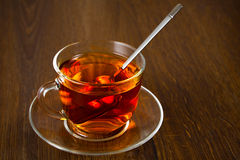 Cup of  tea with fresh leaves of green tea Royalty Free Stock Images