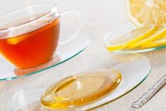 Cup of tea, fresh lemon and honey Royalty Free Stock Image