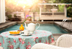 Cup of tea with fresh slice orange fruit and muffin cake on the Royalty Free Stock Photo