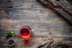 Cup of tea with fresh tea leaves Royalty Free Stock Image