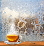 Cup of tea on frosty glass background Stock Image