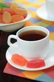 Cup of tea and fruit candy. Royalty Free Stock Image