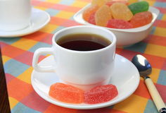 Cup of tea and fruit candy. Royalty Free Stock Photography