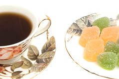 Cup of tea and fruit candy Stock Images