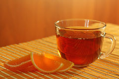 Cup of tea and fruit jelly on a bamboo table cloth Stock Image