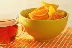 Cup of tea and fruit jelly on a bamboo table cloth Stock Photography