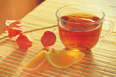 Cup of tea and fruit jelly with physalis Stock Image