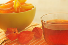Cup of tea and fruit jelly with physalis Stock Photography