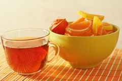 Cup of tea and fruit jelly with physalis Stock Photos
