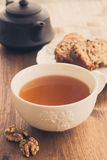 Cup of tea with fruit and nut cake Stock Photos