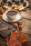 Cup of tea with  gift of nature and vintage notebook  with film filter effect  vertical Stock Photo