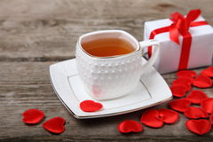 Cup of tea, gift and red hearts Royalty Free Stock Image
