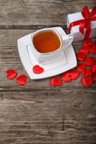 Cup of tea, gift and red hearts Royalty Free Stock Photos