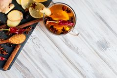 Cup of tea with ginger, lemon and brown sugar. Cup of tea with ginger, lemon, cinnamon, cardamom and brown sugar Royalty Free Stock Images