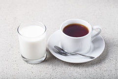 Cup of tea and glass of milk on a light background Stock Photo
