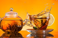 Cup of tea. On glass with orange background Royalty Free Stock Photo
