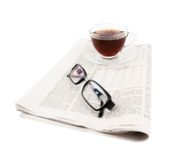 Cup of tea with glasses and newspaper Royalty Free Stock Images