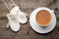 Cup of tea with gloves Royalty Free Stock Images