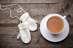 Cup of tea with gloves Stock Photography