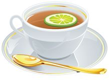 Cup of tea with golden spoon. Stock Photos