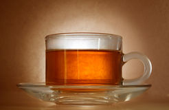 Cup of tea. With a gradient on brown paper Stock Image