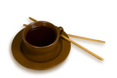 Cup of tea with grain sticks. Tea cup on a saucer and two grain sticks. On a white background Royalty Free Stock Image