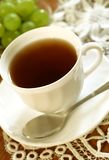 Cup of tea and grapes Stock Photos