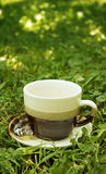 Cup of tea in grass Stock Photos
