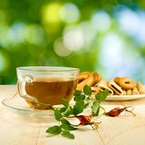 Cup of tea. On green background Royalty Free Stock Photography