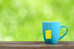 Cup of tea on green background Stock Photo