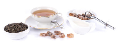 Cup of tea with green dry tea and crystal sugar Stock Images