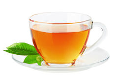 Cup with tea and green leaf Royalty Free Stock Image