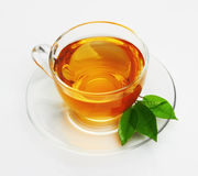 Cup with tea and green leaf royalty free stock photo