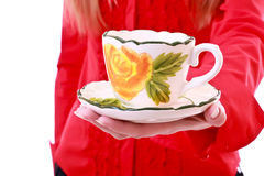 A cup of tea on hand Stock Images