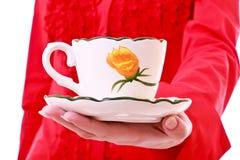 Cup of tea on hand Stock Photos