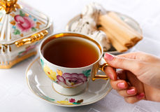Cup of tea in hand Stock Images