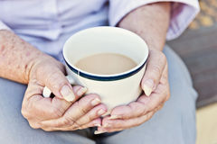 Cup of tea in hands Royalty Free Stock Images