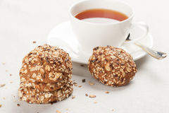 Cup of tea and healthy oat cookies Stock Photo
