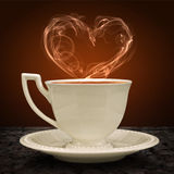 Cup of tea and heart with a pair of tea. Concept graphic. Stock Image