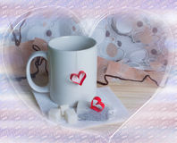 Cup of tea with heart shape Stock Photos