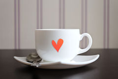 Cup of tea with heart shape on wooden table. Stock Photo