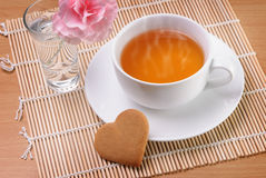 Cup of tea with a heart shaped biscuit Royalty Free Stock Image