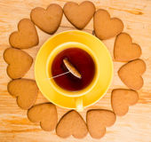 Cup with tea and heart-shaped cookies Stock Photos