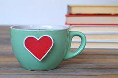 Cup of tea with heart shaped tea bag label Stock Photo